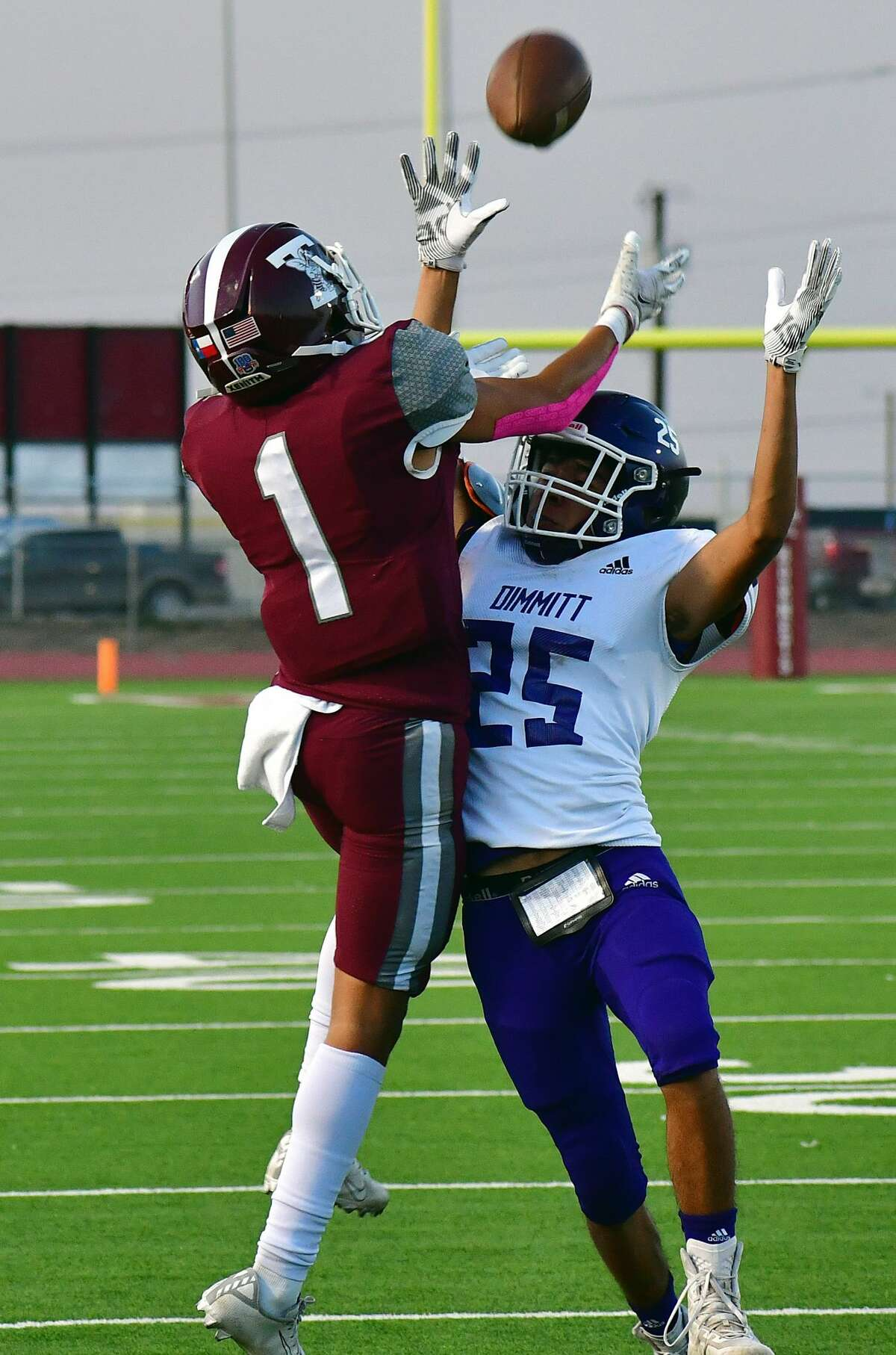 Tulia's Ethan Reyes catches a pass over the head of a Dimmitt defender during their District 3-3A Division II high school football game on Friday, Oct. 2, 2020 in Tulia.