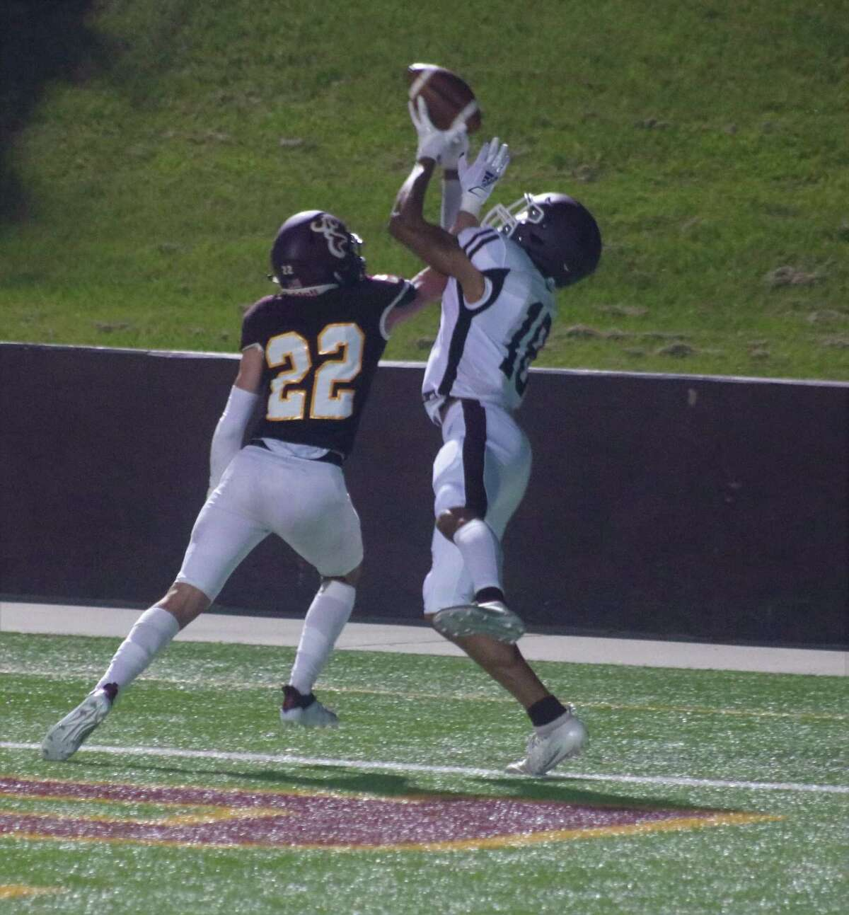 Clear Creek's Jeremiah Cams (18) attempts to haul in this pass in the end zone, but Deer Park's Kai Twitty does his part to break it up during second quarter play.