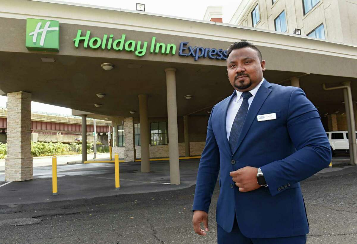 Operations Manager Vicky Sindhu stands outside the Holiday Inn Express on Broadway on Friday, Oct. 2, 2020 in Albany, N.Y. (Lori Van Buren/Times Union)