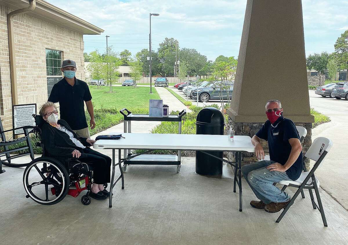 Patients at Cypress Pointe Health and Wellness have been able to visit with each other sitting outside under the portico. They have to remain masked and socially distanced.