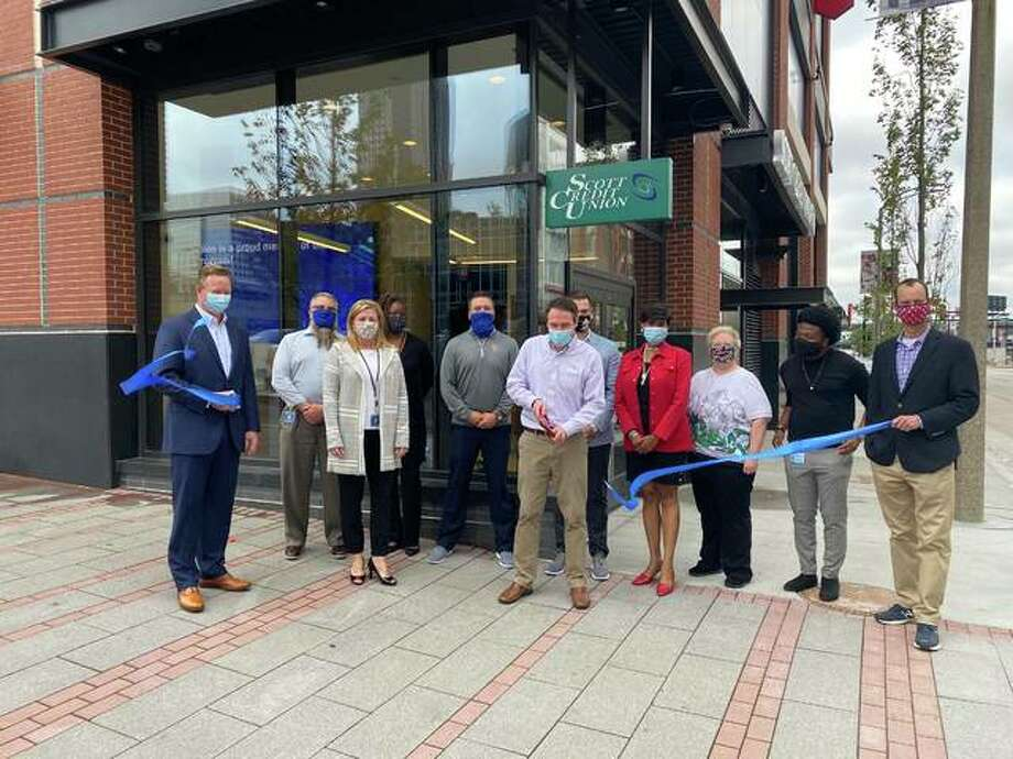 Scott Credit Union officially celebrated the opening of its new branch in Ballpark Village with a ceremonial ribbon cutting on Monday with the St. Louis Regional Chamber of Commerce and representatives from the St. Louis Cardinals and Ballpark Village Photo: For The Intelligencer