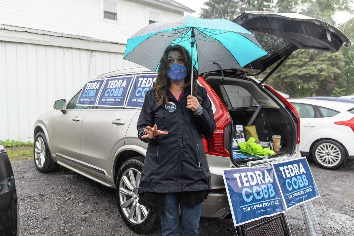 Tedra Cobb, the Democratic candidate for the NY-21 U.S. House seat, holds a campaign event on Sunday, Sept. 13, 2020, in Watertown, N.Y. She met with local voters and handed out yard signs from the Garland City Beer Works parking lot. Cobb faces Republican incumbent Elise Stefanik in November. (Sydney Schaefer/Watertown Daily Times)