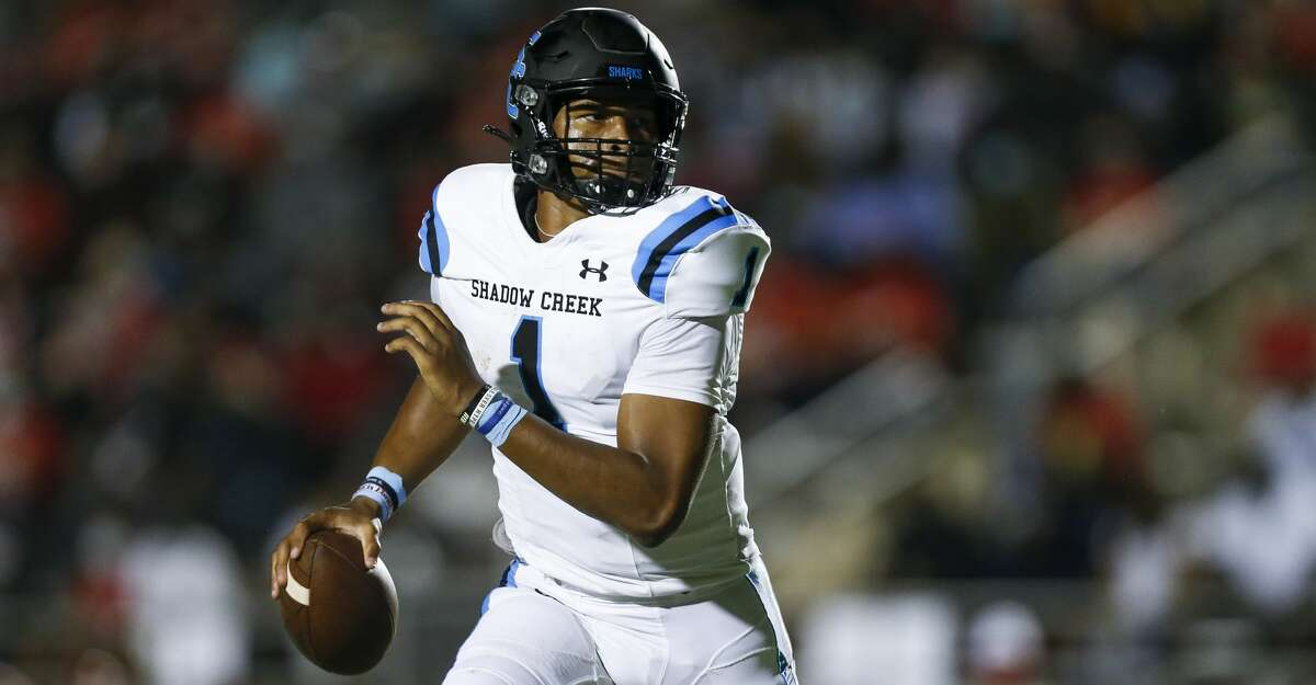 Shadow Creek quarterback Kyron Drones (1) scrambles out of the picket to throw the ball against North Shore during the first half of the game at Galena Park ISD Stadium on Friday, Sept. 25, 2020, in Houston.
