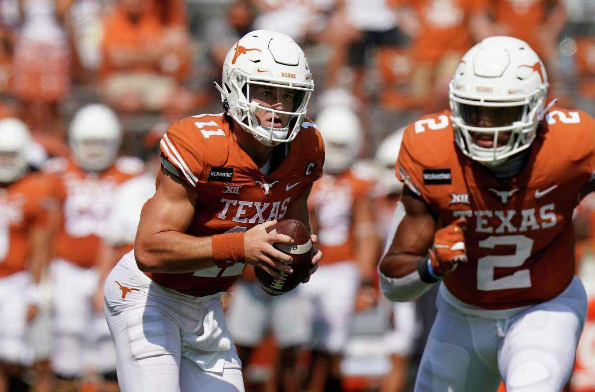 Texas quarterback Sam Ehlinger (11) looks to throw against TCU during the first half of an NCAA college football game, Saturday, Oct. 3, 2020, in Austin, Texas. (AP Photo/Eric Gay)