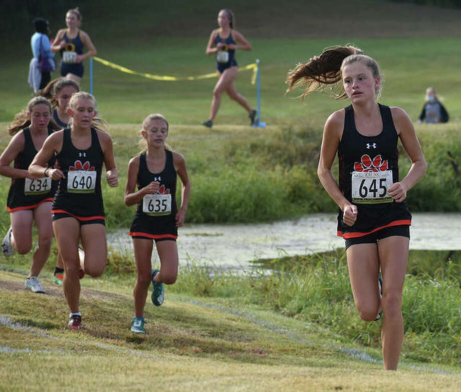 Edwardsville's Dylan Peel runs in front of her teammates Olivia Coll (No. 634), Kaitlyn Loyet (No. 640) and Whitney Dyckman (No. 635) during the Southwestern Conference Meet on Saturday at Clinton Hills Conservation Park. Photo: Matt Kamp|The Intelligencer