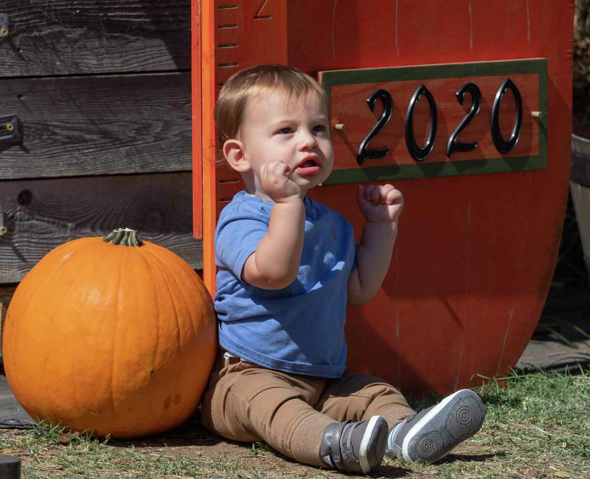 Hayes Stilwell posses for a picture for his mother, Michelle Stilwell 10/03/2020 at the St. Luke's United Methodist Church Pumpkin Patch. Tim Fischer/Reporter-Telegram