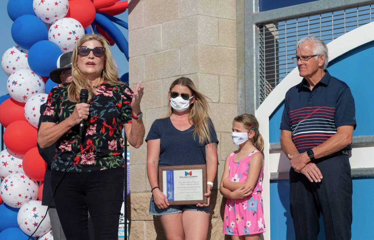 Jan Davidson, with Steve Davidson, right and daughter Katie and granddaughter Rylie thank everyone in the community and business leaders with their help 10/03/2020 at the new Chris Davidson Opportunity Park during the dedication ceremony Saturday morning. Tim Fischer/Reporter-Telegram