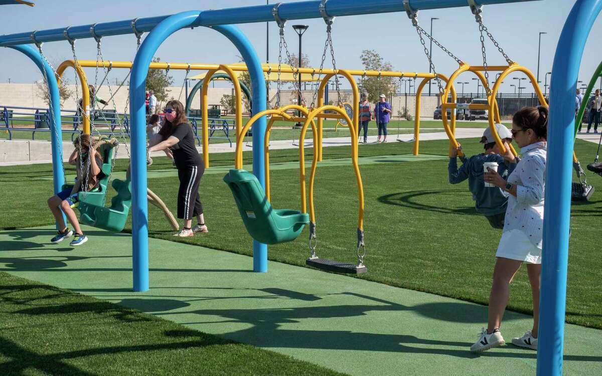 Children and families play 10/03/2020 at the new Chris Davidson Opportunity Park following the dedication ceremony Saturday morning. Tim Fischer/Reporter-Telegram