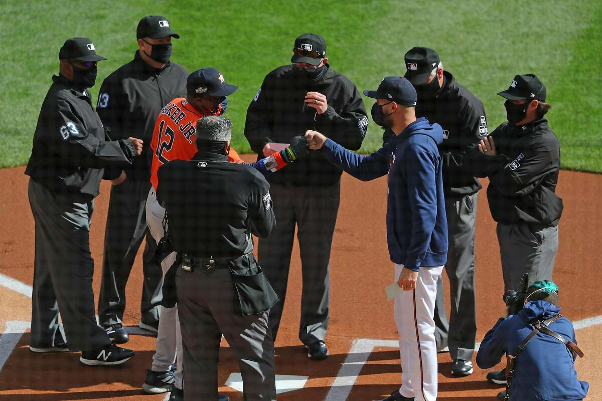 MINNEAPOLIS, MN - SEPTEMBER 30: Houston Astros Manager Dusty Baker and Minnesota Twins Manager Rocco Baldelli fist bump before the start of Game Two of the American League Wildcard series at Target Field on September 30, 2020 in Minneapolis, Minnesota. (Photo by Adam Bettcher/Getty Images)