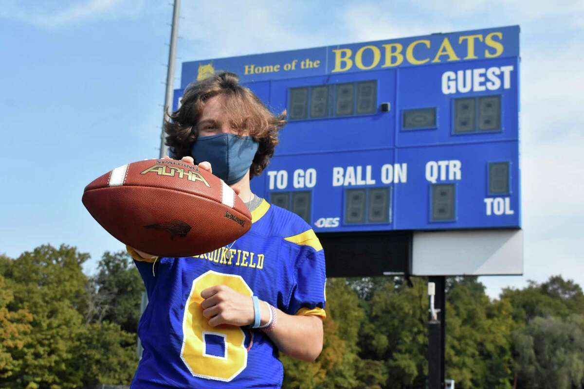 Brookfield quarterback Jed Rajcula poses in front of the scoreboard at Brookfield HS on Friday, Sept. 25, 2020.