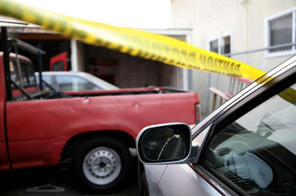 These vehicles were struck by bullets when 16-year-old Aaron Pryor was fatally shot on Sunday, photographed on Thursday, October 1, 2020, in Oakland, Calif. The Skyline High School football player was killed in a driveway near the 5800 block of Elizabeth Street in the Melrose neighborhood.