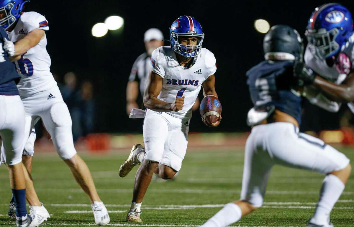 West Brook quarterback Bryce Anderson (1) scores a rushing touchdown against Tomball Memorial during the second half of the game at Tomball ISD Stadium Friday, Oct. 2, 2020, in Tomball, Texas.