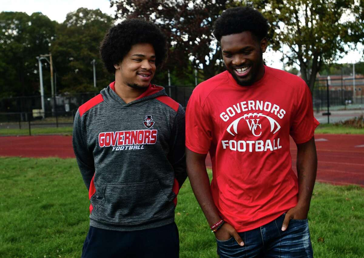 """Wilbur Cross football players Jabez Cubiz, left, and Armon Hyslop spoke about the impact of not being able to play due to the pandemic. """"Everyone has their own individual problems and their own place to run to,"""" Cubiz said. """"Football is mine. You take that away from them and the only place they have to go is to the bad stuff."""