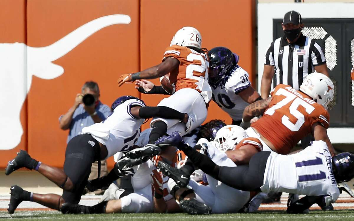 TCU's Garret Wallow (30) strips the ball from Texas' Keaontay Ingram late in the fourth quarter.