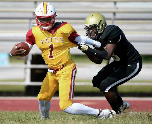 Yates quarterback Broderick Brown (1) is tackled by North Forest linebacker Jacoby Henry during the first half of a high school football game, Saturday, Oct. 3, 2020, in Houston. Photo: Eric Christian Smith, Contributor / Houston Chronicle