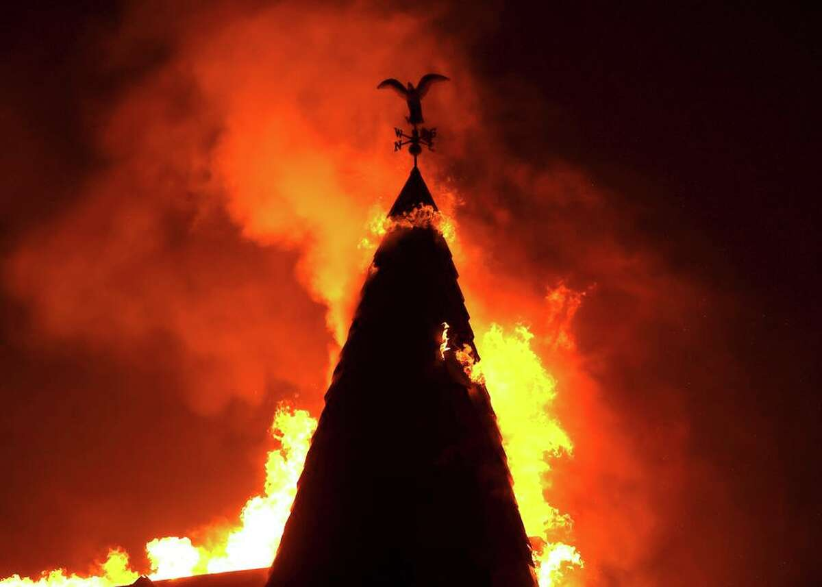 The steeple at Chateau Boswell Winery in St. Helena burns in the Glass Fire last week. The blaze remains a serious threat.