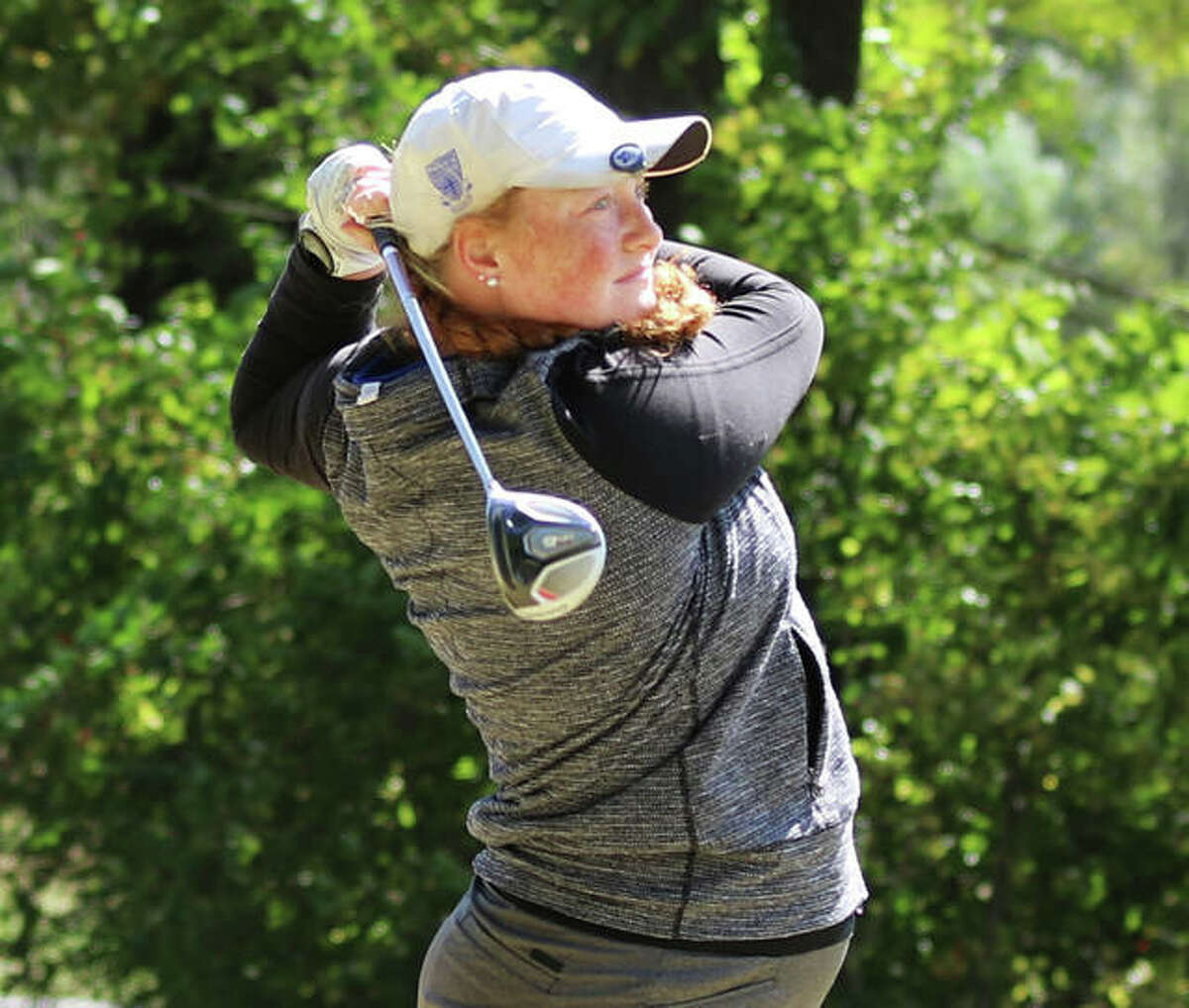 Marquette Catholic's Gracie Piar watches her drive Thursday in the Gary Bair Invite at Oak Brook in Edwardsville.