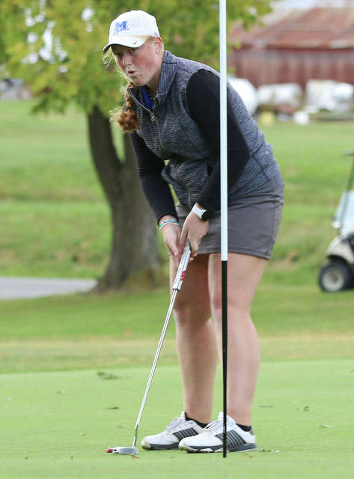Marquette's Gracie Piar breathes a sigh of relief after her short putt rims the cup before falling on hole No. 2 at Oak Brook on Thursday in Edwardsville's Gary Bair Invite. Piar was tourney medalist at 73.