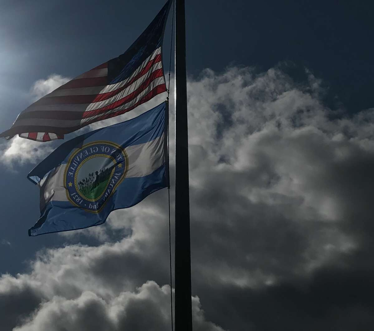 Officials raise a new flag at Glenville's Town Hall Saturday, Oct. 3. The town celebrates its 200th year this year.