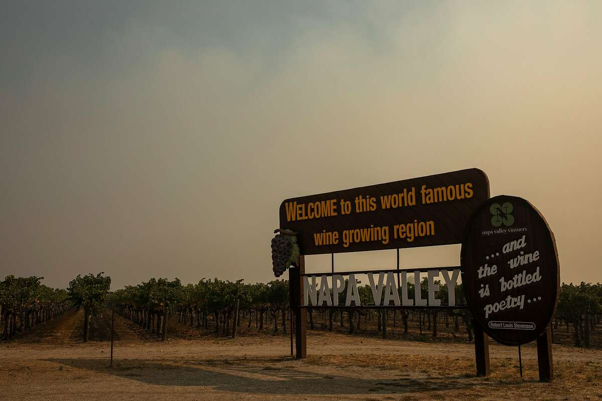 The Napa Valley welcome sign as the smoke from the Glass Fire fills the area, Saturday, Oct. 3, 2020, in St. Helena, Calif.