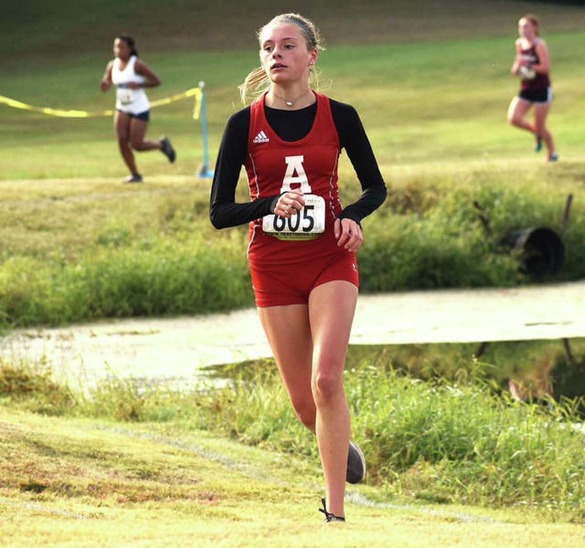 Alton's Alayna Rabozzi runs to a 17th-place cross country finish Saturday at the Southwestern Conference Meet at Clinton Hills Conservation Park in Swansea.