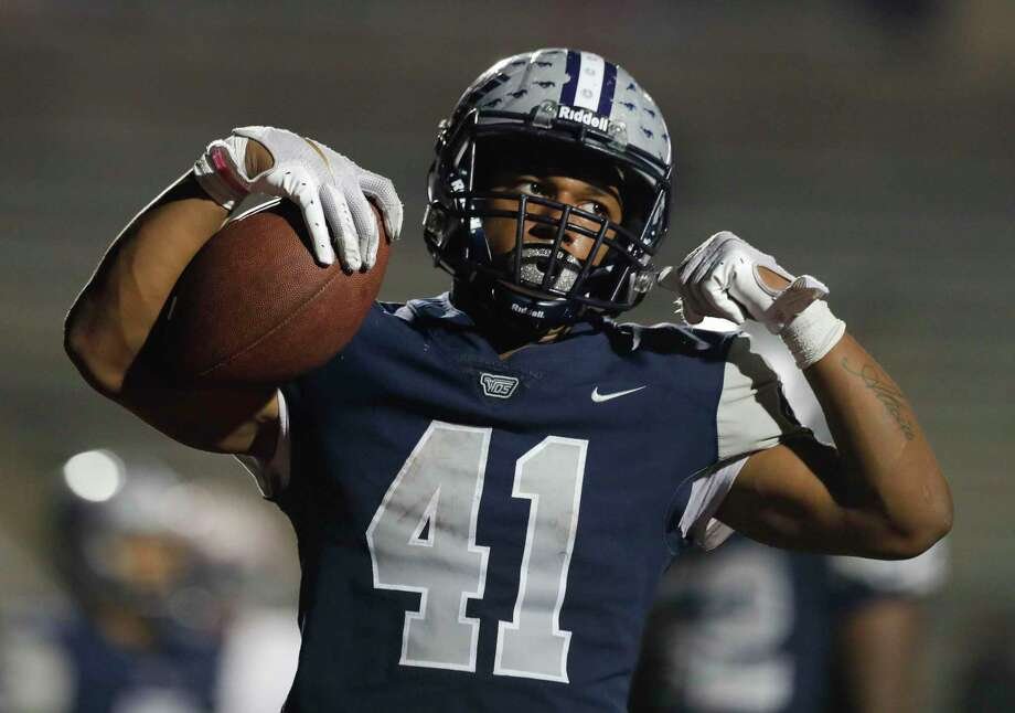 West Orange-Stark running back Elijah Gales (41) reacts after running for a 7-yard touchdown during the second quarter of a Region III-4A Division II semifinal high school football playoff game at Randall Reed Stadium, Friday, Nov. 29, 2019, in New Caney. Photo: Jason Fochtman, Houston Chronicle / Staff Photographer / Houston Chronicle