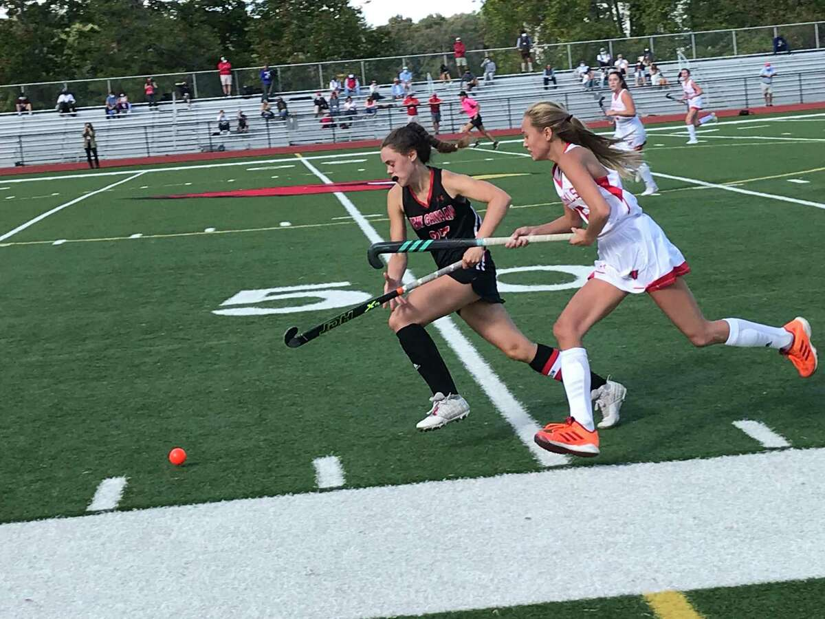 Caroline Brooks of New Canaan, left, retrieves the ball, while being pursued during the Rams' field hockey game against Greenwich on Saturday, October 3, 2020, in Greenwich, Connecticut.