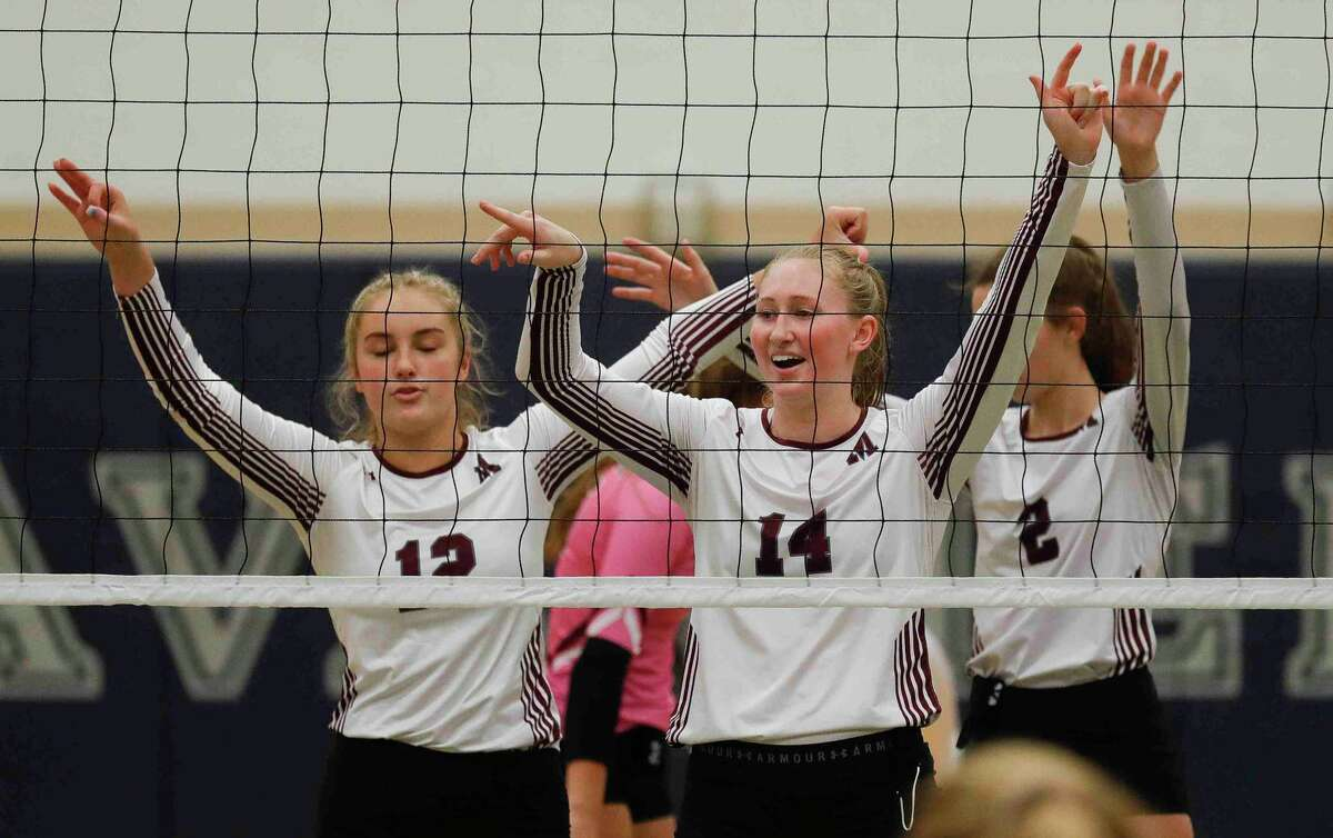 Magnolia's Ellie Anderson (14) awaits a serve beside Sydney Gentry (12) and Chloe Richards (2) during the first set of a non-district high school volleyball match at College Park High School, Saturday, Sept. 26, 2020, in The Woodlands.