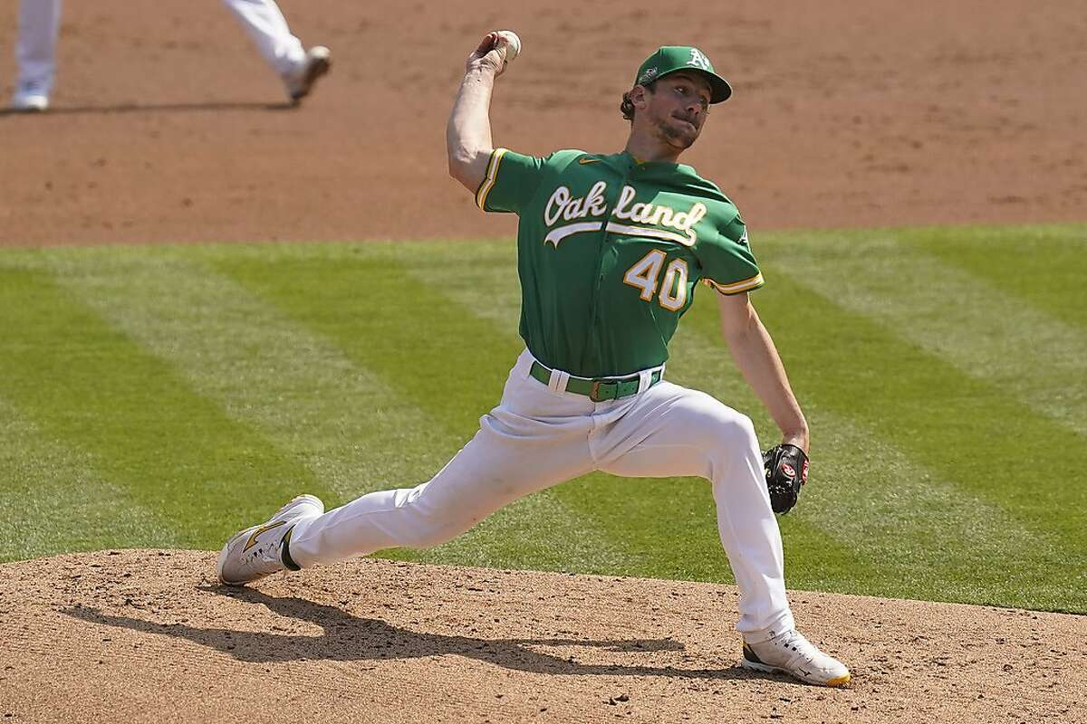 Oakland Athletics' Chris Bassitt (40) pitches against the Chicago White Sox during the second inning of Game 2 of an American League wild-card baseball series Wednesday, Sept. 30, 2020, in Oakland, Calif. (AP Photo/Eric Risberg)