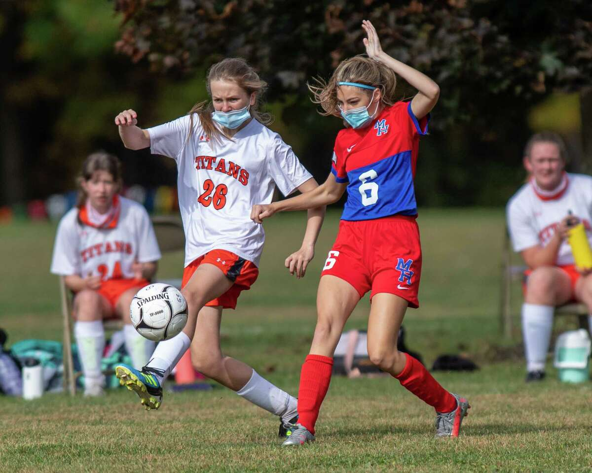 Taconic Hills freshman Samantha Henderson beats Maple Hill junior Lucienne Sherling to the ball during a game at Maple Hill High School on Saturday, Oct. 3, 2020 (Jim Franco/special to the Times Union.)