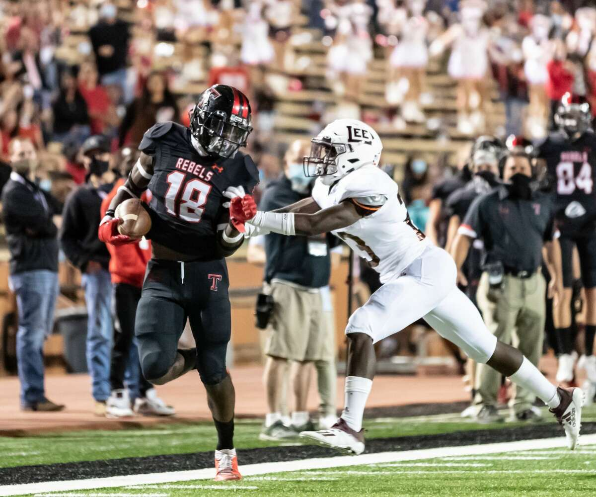 Lee cornerback Canyon Moses, right, shoves Amarillo Tascosa'sDarius Sanders out of bounds during Friday's game at Dick Bivins Stadium in Amarillo.