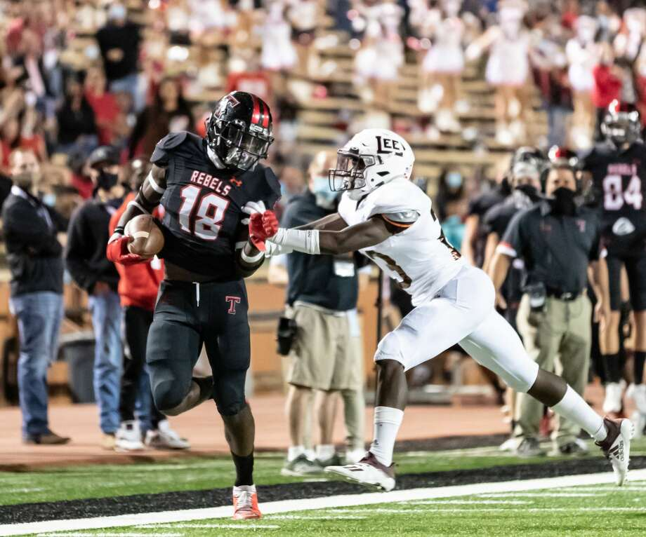 Lee cornerback Canyon Moses, right, shoves Amarillo Tascosa'sDarius Sanders out of bounds during Friday's game at Dick Bivins Stadium in Amarillo. Photo: Thomas D. Carver