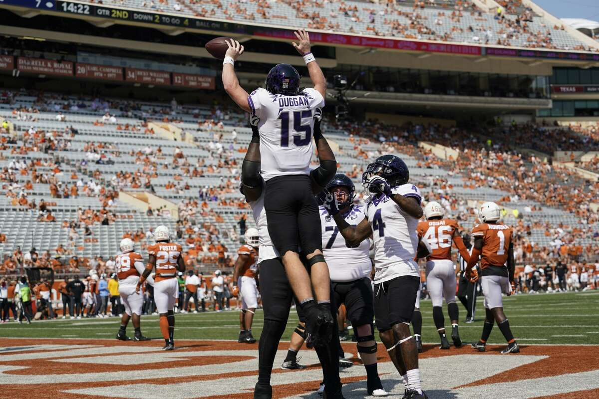 TCU quarterback Max Duggan (15) is lifted after scoring a touchdown on a run against Texas during the first half of an NCAA college football game, Saturday, Oct. 3, 2020, in Austin, Texas. (AP Photo/Eric Gay)