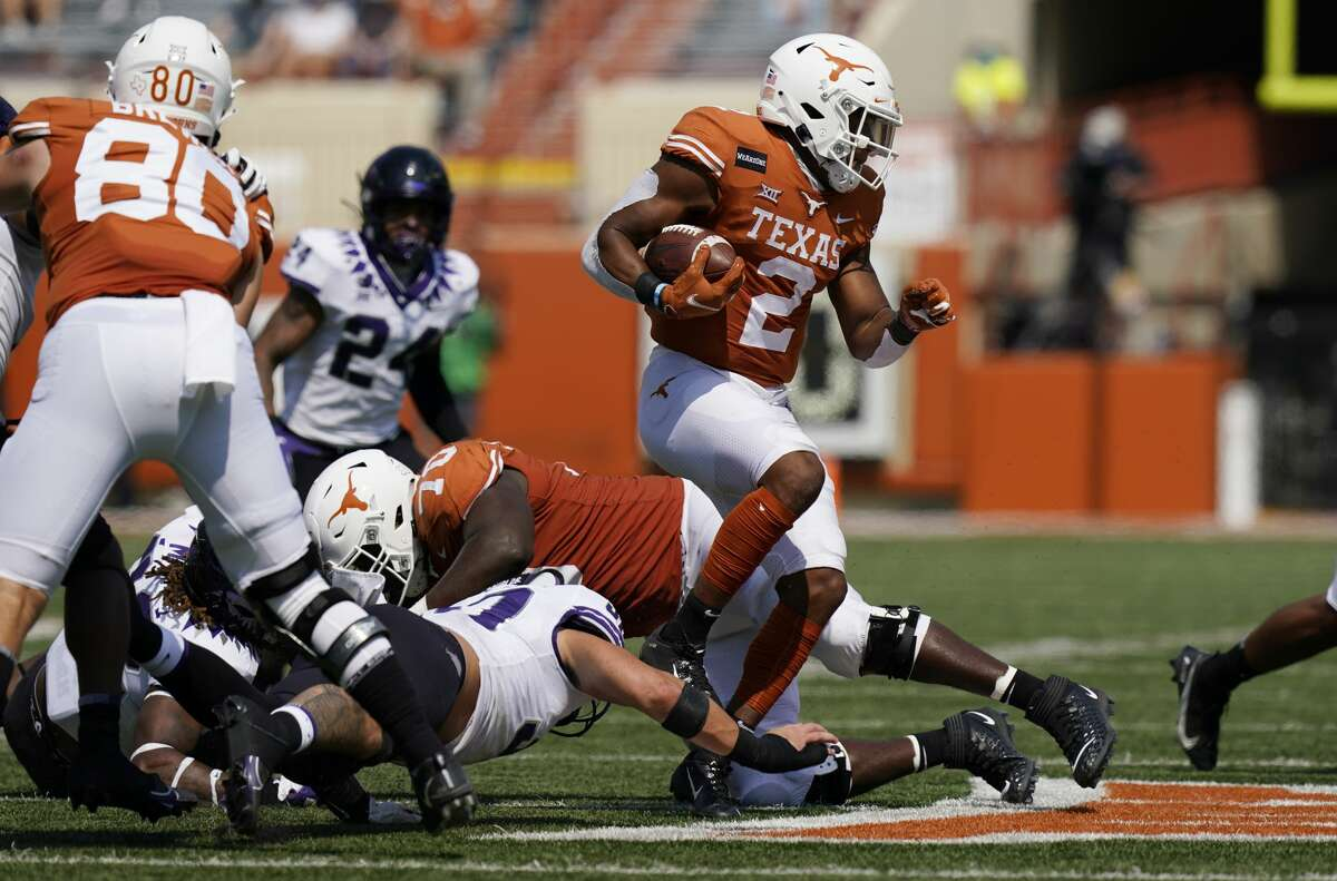Texas running back Roschon Johnson (2) runs against TCU during the second half of an NCAA college football game, Saturday, Oct. 3, 2020, in Austin, Texas. (AP Photo/Eric Gay)