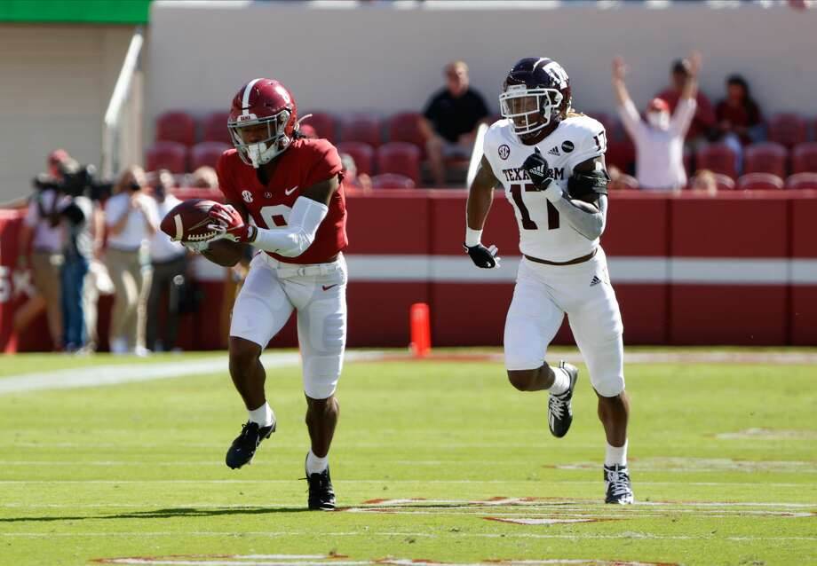 TUSCALOOSA, AL - OCTOBER 3: John Metchie III #8 of the Alabama Crimson Tide makes a catch ahead of Jaylon Jones #17 of the Texas A&M Aggies on October 3, 2020 at Bryant-Denny Stadium in Tuscaloosa, Alabama. (Photo by UA Athletics/Collegiate Images/Getty Images) Photo: Collegiate Images/Collegiate Images Via Getty Imag / 2020 Collegiate Images