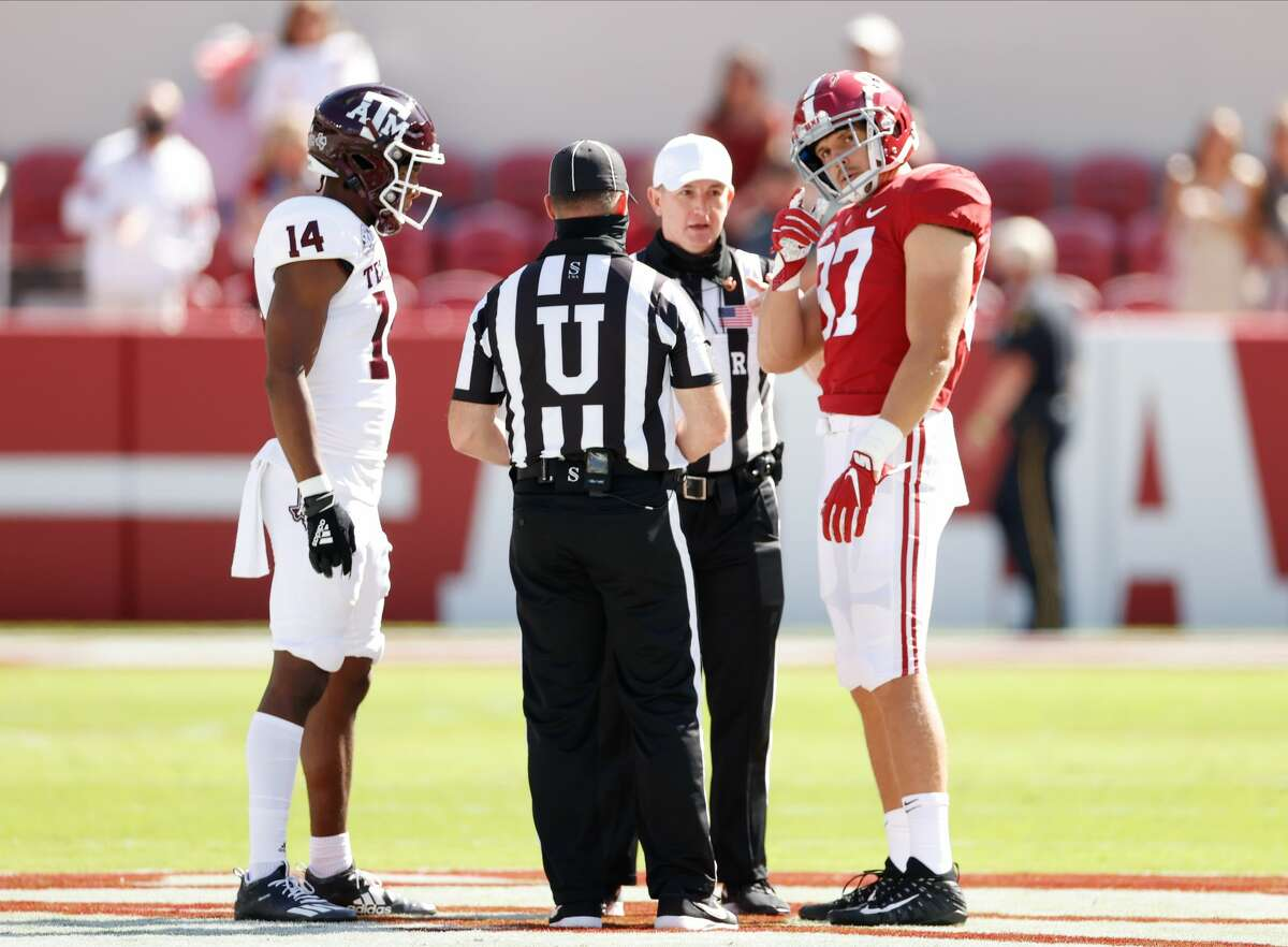 TUSCALOOSA, AL - OCTOBER 3: Miller Forristall #87 of the Alabama Crimson Tide and Keldrick Carper #14 of the Texas A&M Aggies during the coin toss on October 3, 2020 at Bryant-Denny Stadium in Tuscaloosa, Alabama. (Photo by UA Athletics/Collegiate Images/Getty Images)