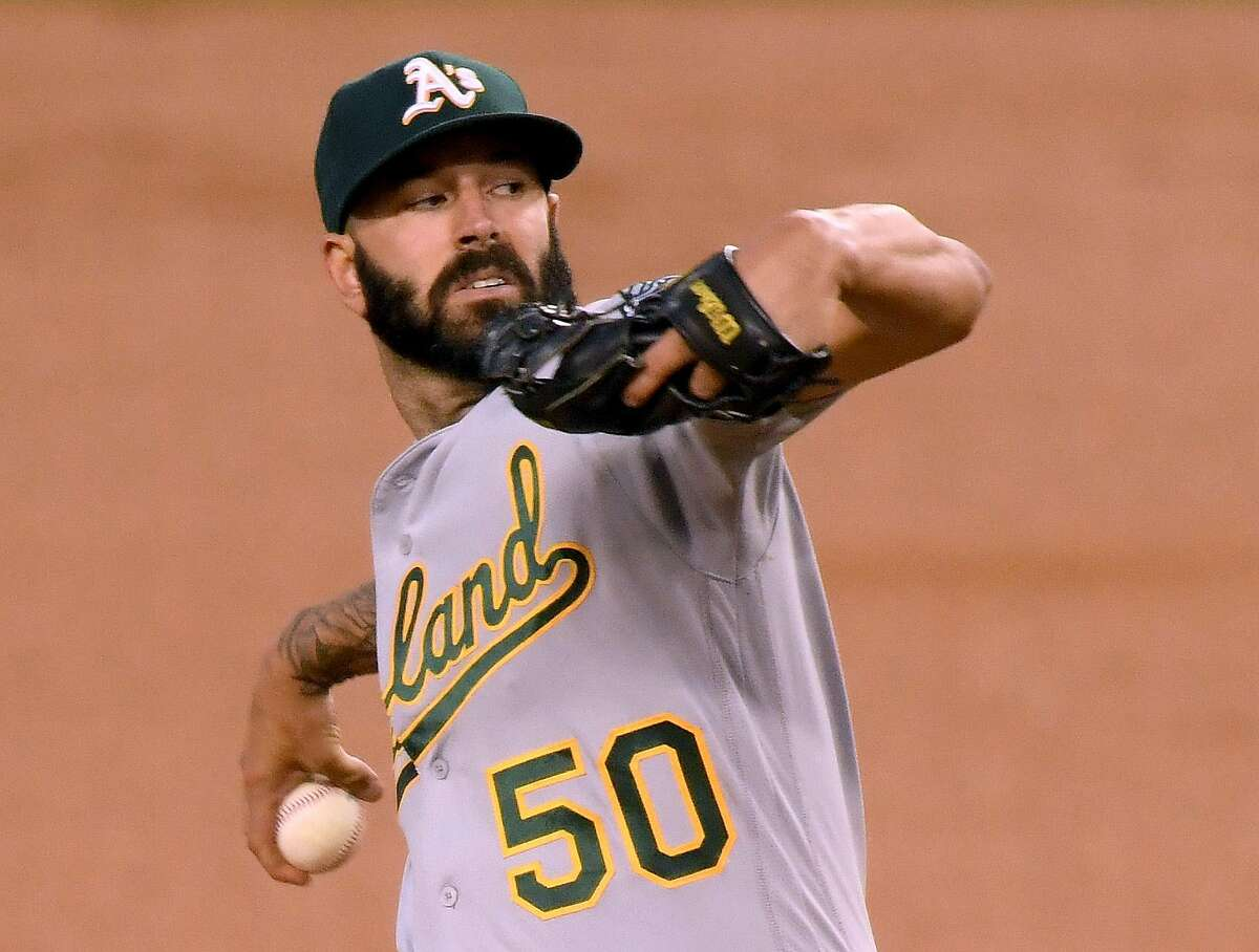 LOS ANGELES, CALIFORNIA - SEPTEMBER 24: Mike Fiers #50 of the Oakland Athletics pitches during the first inning against the Los Angeles Dodgers at Dodger Stadium on September 24, 2020 in Los Angeles, California. (Photo by Harry How/Getty Images)