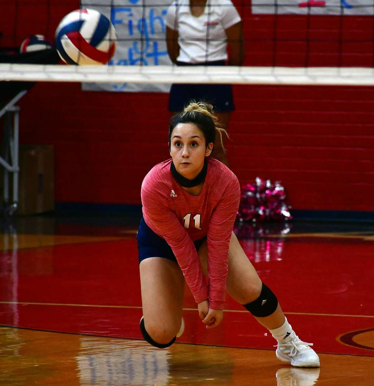 Plainview's Emily Sigala charges forward on a serve receive during a District 3-5A high school volleyball game against Amarillo Caprock on Saturday, Oct. 3, 2020 in the Dog House at Plainview High School.