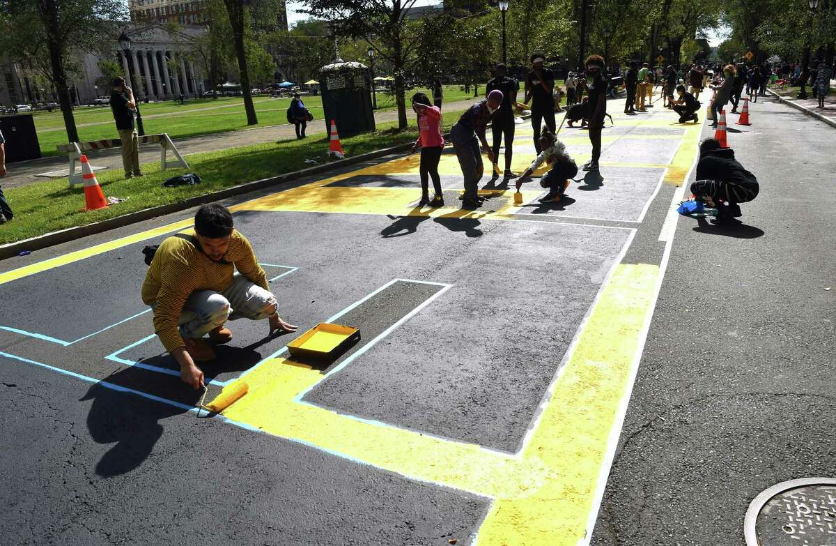 Volunteers paint a Black Lives Matter mural on Temple Street next to the New Haven Green on October 3, 2020.