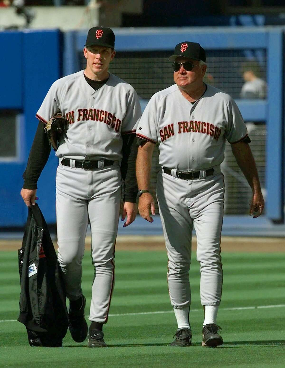 San Francisco Giants starting pitcher Orel Hershiser, left, and his pitching coach Ron Perranoski walk to the dugout from the bullpen to face his former team, the Los Angeles Dodgers, at Dodger Stadium in Los Angeles, Wednesday, July 15, 1998. Perranoski used to be the Dodgers pitching coach. (AP Photo/Kevork Djansezian)