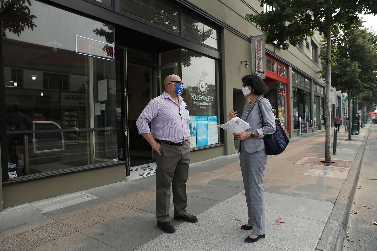 Alameda Mayor Marilyn Ezzy Ashcraft speaks with Cesar Gamero of Alameda on Park Street outside of a building that is a pre-Measure A example of multifamily housing.