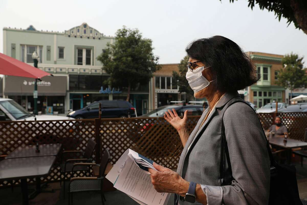 Alameda Mayor Marilyn Ezzy Ashcraft walks on Park Street, across from a pre-Measure A multifamily building.