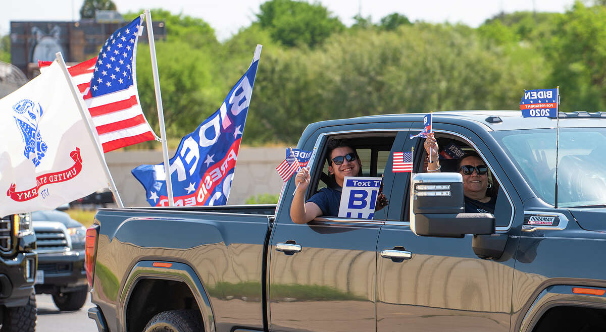 Supporters of Presidential Candidate Joe Biden show their support as they traverse Laredo with decorated cars, Saturday, Oct. 3, 2020, during the Ridin' with Biden parade.
