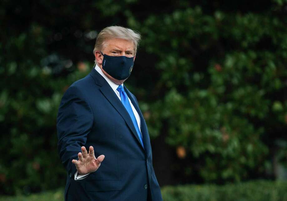 President Donald Trump walks to Marine One on the South Lawn of the White House on Friday afternoon en route to Walter Reed Military Medical Center. After testing positive for the novel coronavirus, Trump remained Saturday at the military hospital. Photo: Photo By Amanda Voisard For The Washington Post / For The Washington Post
