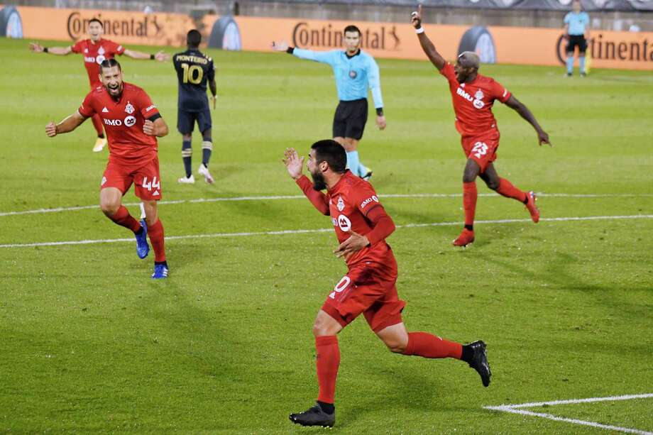Toronto FC's Alejandro Pozuelo, front, celebrates his goal against the Philadelphia Union with teammates during an Oct. 3 game in East Hartford. Photo: Jessica Hill / Associated Press / Copyright 2020. The Associated Press. All rights reserved