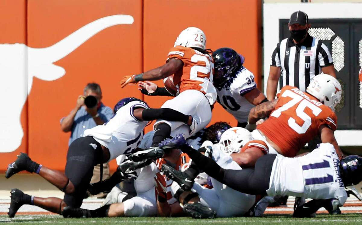 AUSTIN, TEXAS - OCTOBER 03: Garret Wallow #30 of the TCU Horned Frogs forces a fumble by Keaontay Ingram #26 of the Texas Longhorns near the goal line in the fourth quarter at Darrell K Royal-Texas Memorial Stadium on October 03, 2020 in Austin, Texas. (Photo by Tim Warner/Getty Images)