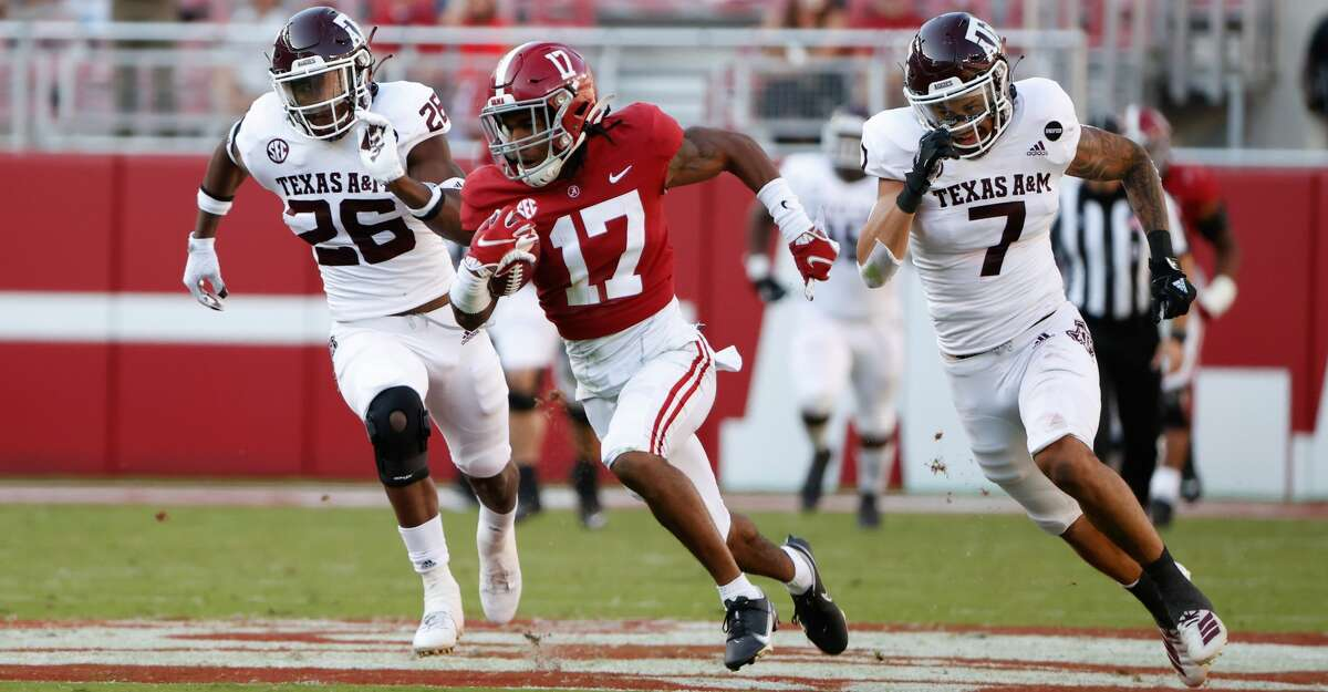 Jaylen Waddle #17 of the Alabama Crimson Tide runs the ball upfield against the Texas A&M Aggies on October 3, 2020 at Bryant-Denny Stadium in Tuscaloosa, Alabama. (Photo by UA Athletics/Collegiate Images/Getty Images)