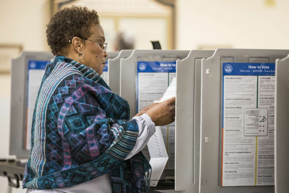 A woman votes in the California primary on June 7, 2016, at City Hall in San Francisco.