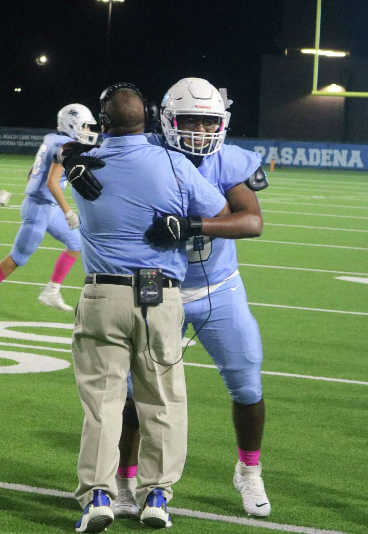 Sam Rayburn coaches and players embraced Saturday night, following the team's 7-6 win over Milby, ending a 29-game losing streak that had dated back to the 2017 season.