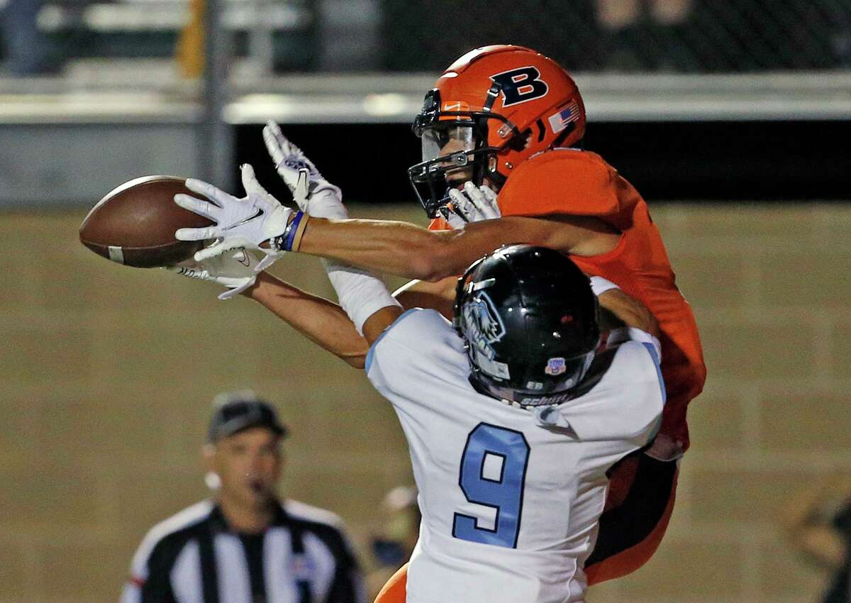 Brandeis WR Josh Suarez fights for a reception against Harlan Logan Pivirotto but a penalty on both sides was called nullify the play. Harlan v Brandeis at Farris Stadium on Saturday, October 3, 2020. Halftime score is Brandeis 28- Harlan 7.